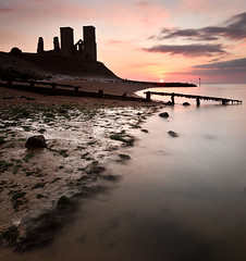 Reculver Sunset (Tired but Willin) Tags: sunset sea seascape castle water clouds evening bay coast kent rocks long exposure tired coastline but whitstable herne groynes willin reculver