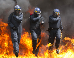 Wall of Flame (Greater Manchester Police) Tags: manchester fire flames police flame patrol gmp onfire inflames policeofficer petrolbomb britishpolice policetraining fireretardant ukpolice fireretardantsuit greatermanchesterpolice policephotography publicordertraining unitedkingdompolice policeriottraining maninflames policeofficerinflames policecrashhelmet policepublicordertraining flameretrardant petrolreception specialistpolicetraining pesoninflames policepublicorderkit