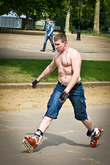 Muscle man on skates (jrmsctt) Tags: people woman white lake man black color colour london water thames portraits river view couples desire hydepark olympics canarywharf skates serpentine gmt london2012 expressyourself streetportraiture streettogs