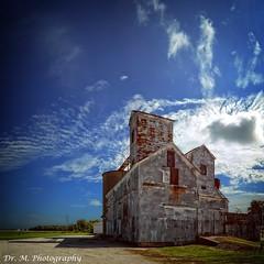 Community Grain Elevator (Dr. M.) Tags: clouds building abandoned nikon d7000 shadows ohio burgoon farming grainelevator community smalltown