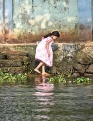 Nature's Child (The Spirit of the World) Tags: kerala india backwaters child playing water wall reflections waterflowers southernindia childhood local candid portrait lake