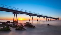 First lights (barbaarnau) Tags: sunrise morning sea water beach blue sun rocks summer pier sand seascape dawn first light badalona