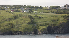 Torbay II (Loops666) Tags: torbay rural newfoundland aroundthebay water cliffs hill slope grass trees outside houses community town