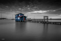 Blue/Red Beach House/Cabo Rojo, P.R. (GOJR.) Tags: longexposure blue sunset red bw white house seascape color beach clouds landscape boats island twilight nikon puertorico playa nubes isla caborojo boqueron casaplaya nikon1224mmf4 seacscape nikond300s banearioboqueron