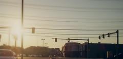 slowwww down (sundaescoop 8)) Tags: street sun car yellow glare slow traffic down flare stoplight yield stores