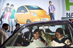 Tata Nano at Auto Expo 2012 - Delhi, India (Maciej Dakowicz) Tags: city people urban india smile car person asia delhi tata capital moto nano carshow newdelhi 2012 autoexpo tatanano