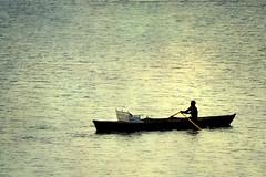One is solitude... (Atul Tater) Tags: lake boat boating nainital