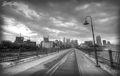 Stone Arch Bridge (Mr. Moment) Tags: park bridge bw white black building minnesota skyline america skyscraper river landscape us cityscape unitedstates minneapolis infrastructure mississippiriver lightpost hdr guthrie stanthony goldmedalflour stonearchbridge millcitymuseum