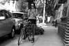 jane street (omoo) Tags: newyorkcity bw girl bike bicycle boots westvillage cellphone tights sidewalk prettygirl streetscenes greenwichvillage janestreet bwphotograph greytights girlonabicycle summerboots bootsandal dscn7388 girlwithamobilephone messagebreak girlcheckshermessages