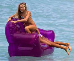 Balancing Act (coqrico) Tags: ocean sea usa girl hawaii pacific waikiki oahu seat young floating device rico sofa teen inflatable bikini blonde teenager divan leffanta