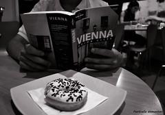 Preparing Wien with a Donuts. (Particelle elementari) Tags: vienna wien city travel blackandwhite bw italy white black rome roma book italia bn biblioteca donuts bookshop bianco interrail viaggio cibo bianconero vacanza biancoenero ciambella guidaturistica mygearandme