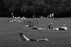 Summered somewhere - II (Catch the dream) Tags: summer bw newyork men monochrome bicycle unitedstatesofamerica leisure reclining relaxation relaxed bnw sheepmeadow