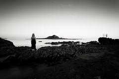 Lone woman (Andrew S. Gibson) Tags: longexposure sea newzealand portrait blackandwhite seascape water canon landscape wellington islandbay 30seconds ef1740mmf4l lonewoman eos5dmarkii
