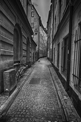 Cobbled street (la1cna) Tags: monochrome walking sweden bnw oldbuilding street city streetphoto summer urbanliving fujifilm stockholm streetphotography travel urban textures 21mm