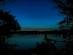 Blue hour by the river (angelinas) Tags: bluehour blue nature natura sky skyline nighttime dusk twilight rivers riverscape riverside trees landscapes skyscpaes skyscapes montreal quebec canada