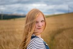 Windy Summer's Day (Silver Machine) Tags: macduff scotland portrait girl barleyfield summer smile teenager outdoor fujifilm fujifilmxt10 fujinonxf35mmf2rwr
