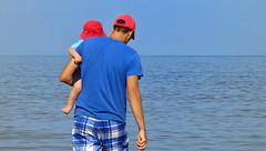 Discovering the Ocean (Danny VB) Tags: discovering ocean father boy son baby waves fatherandson redhat gaspsie qubec canada blue redandblue rougeetbleu atlantic olympus capdespoir july summer