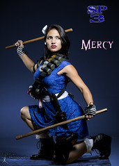 Sucker Punched 3 - Mercy (4) (FightGuy Photography) Tags: cosplay womenofcosplay weapon badass dangerousbeauty weapons womenwithweapons suckerpunched studiophotography rainn fightguyphotography warrior warriorwoman armor boots belt grenade ribbon brunette asian escrima crouch ilyana