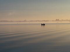 Two man in a boat (Radek Fluder) Tags: morning polska river mist boat fog narew light poland