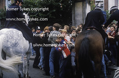 police on horse back control teen football fans chelsea london 1980s (Homer Sykes) Tags: uk england london english football chelsea britain soccer teenagers police teen 80s mounted british fans 1980s horseback teenage footballfans greaterlondon archivestock