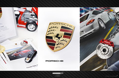I love Porsche [1/?] (Fahad Al-Robah) Tags: blue red white car sign logo keys golden keyring propaganda ring announcement porsche slogan