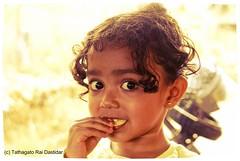I love chips! (trdastidar) Tags: portrait india children raw child kerala backlit wayanad backlighting childrensportrait kalpetta
