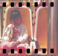 Those carefree years (Plain Bananas) Tags: pink portrait film girl playground 35mm children lomo lomography child play dress ride girly innocent diana innocence lunapark years dianaf playful carefree tutu sprocket
