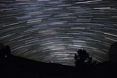 Milky Way Star Trails! (RuizJ) Tags: longexposure sky color night canon texas desert fisheye astrophotography nightsky lighttrails saturn 8mm virgo libra startrails stargazing m7 spica milkyway scorpius sagitarius mcdonaldobservatory 550d lagoonnebula rokinon t2i kissx4