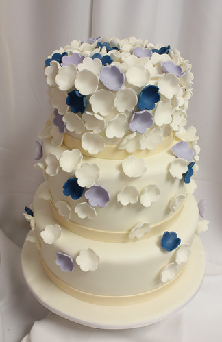 Tiny Punched Flowers Falling Wedding Cake