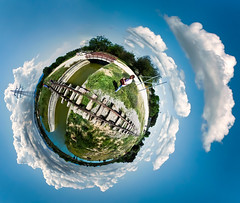 It was May 1st and the sun was so bright (amfipolos) Tags: park sunshine photoshop outdoors spring may railway athens sonycybershot labourday polarcoordinates trainrails littleplanet stereographicprojection pixelbender
