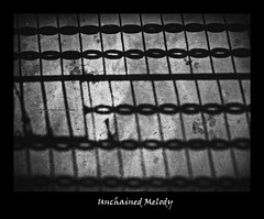 unchained melody (Fortunes2011.Toy Heart) Tags: blackandwhite bw texture monochrome silhouette metal dark grey chains nikon shadows framed expressions naturallight monotone grill chain getty shadesofgrey emotions sorrow interruption gettyimages sentiments unchainedmelody weakestlink brokenchain photoscape nikoncoolpixl120 fortunes2011 macropixcom