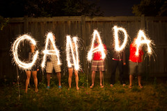 Canada Day Sparklers (Jean Vaillancourt) Tags: longexposure family girls friends light party summer canada boys night canon fun effects fire eos rebel lights backyard exposure day time fireworks outdoor ottawa pride sparklers special celebration flame national shutter patriot canadaday pyro patriotism sparkler sparks lapse 2012 nationalholiday t3i pyrotechnic civicpride 600d canoneos600drebelt3i