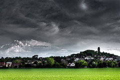 Stormy weather (Michel Couprie) Tags: trees houses light storm france green tower grass clouds day tour clairobscur essonne montlhéry