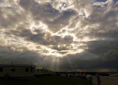 sunbeams over reighton (jasonmgabriel) Tags: sunset sea sky coast meadow sunbeams reighton