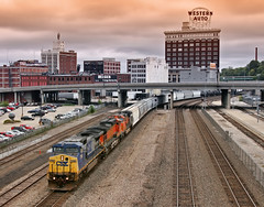 Freight Train in Downtown Kansas City (Dave Toussaint (www.photographersnature.com)) Tags: railroad travel orange usa 20d nature train sunrise canon landscape photography photo october downtown track glow exploring rail mo kansascity missouri unionstation freight bnsf westbound glint 2007 dash8 csx westernauto subdivision burlingtonnorthernsantafe gndfilter thegalaxy c408w photographersnaturecom davetoussaint mygearandme flickrstruereflection1 flickrstruereflection2