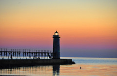 Manistee Lighthouse (Katy Silberger) Tags: sunset lighthouse silhouette michigan manisteemi colorphotoaward nikond90 manisteenorthpierlighthouse