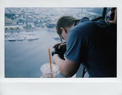 Matt on 'Top of the World' (ashleycampbell) Tags: camera film water canon matt polaroid boats md fuji view maryland baltimore instant innerharbor brasch mattbrasch fuji210wideformatinstantcam