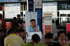 People Talking on the Phone (rickihuang) Tags: china people 3 airport call capital beijing terminal international  t3  capture talking potrait
