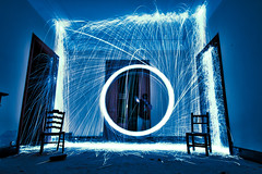 A portal for two [Explore] (futhark) Tags: door longexposure blue light lightpainting cold lana luz wool wheel silhouette electric night canon dark painting circle fire noche licht puerta chair energy warm long exposure paint