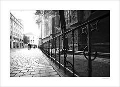 Ghent...in perspective (Zino2009 (bob van den berg)) Tags: belgium town old mediaval contrasts black white light depth zoom fence perspective pedestrians walk centre fecade church iron metal zino2009 bobvandenberg