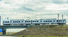 rtd's new a line train (pbo31) Tags: denver colorado nikon d810 color september 2016 summer boury pbo31 travel denverinternationalairport dia sky transportation rtd new line train rail commuter track airport transit public motion