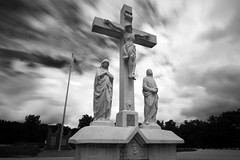 Fort Sheridan Cemetary (Sean Anderson Media) Tags: sonya7rii wonderpana filter nd1000 motionblur fortsheridan highwood illinois crucifix christ jesus fortsheridancemetery cemetery memorial statue mary americanflag militarycemetery graveyard flagwaving movieclouds sky motion cloudsinmotion blackandwhite monochrome moody dramatic 15mm zeiss15mm wonderpanafreearc fotodiox fotodioxpro apsccrop zeissdistagon15mmf28 longexposure