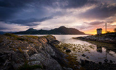 Otrya II (Arvid Bjrkqvist) Tags: norway landscape coast water ocean sea island mountains sunset molde purple yellow blue rocks cliffs house clouds sky calm panorama pano light norge