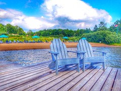 All quiet at the The Beach (CCphotoworks) Tags: august nikon leisure outdoors ccphotoworks sandy lakeofbaysontario bluewateracres canadianflag flag emptychairs peaceful quiet sand lakeshore lakes water dock chairs adriondackchairs canada ontario niceweather weather lakeofbays vacations cottagelife muskokachairs beach