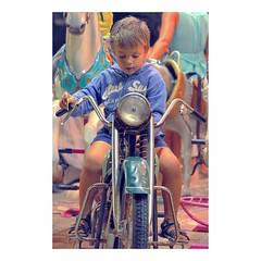 (tifanm_laurent) Tags: lagrandemotte montpellier herault garconnet boy summer holidays vacances moto mange carousel enfance children childhood child kid enfant fteforaine