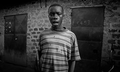 Kampala Revisited II (gunnisal) Tags: africa portrait blackandwhite bw boy kampala uganda face street gunnisal