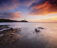 Turnberry Lighthouse (Stuart Stevenson) Tags: uk longexposure sunset sea lighthouse beach nature beautiful night clouds photography evening coast scotland rocks waves famous scottish wideangle landmark barnacles colourful westcoast northchannel ayrshire limpets irishsea clydevalley canon1740mm turnberrylighthouse thanksforviewing vertorama canon5dmkii stuartstevenson stuartstevenson