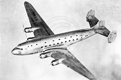 Douglas DC-4 Three Fin Propliner NX18100 Air to Air (The Aviation Photo Company) Tags: 1930s aircraft douglas airliner airtoair dc4 propliner threefin nx18100