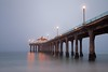 Misty Dawn - USA (SteveMcDonaldPhotography) Tags: usa mist beach america pier sand manhattanbeach atlanticocean manhattanpier
