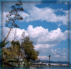 Layers Of Cloudy Blue! ('cosmicgirl1960') Tags: flowers blue sea sky plants mountains nature gardens clouds spain parks costadelsol lamps marbella yabbadabbadoo worldflowers